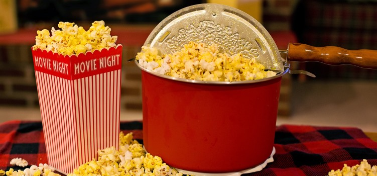 popcorn in a pan and in a box with movie night on it