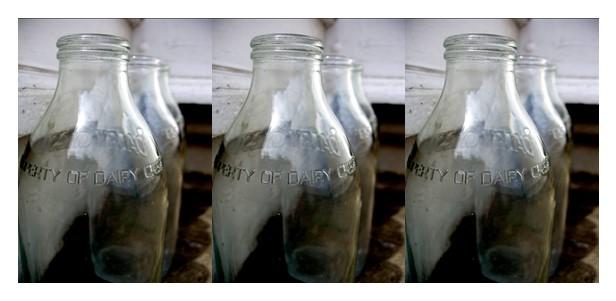 a row of empty glass milk bottles